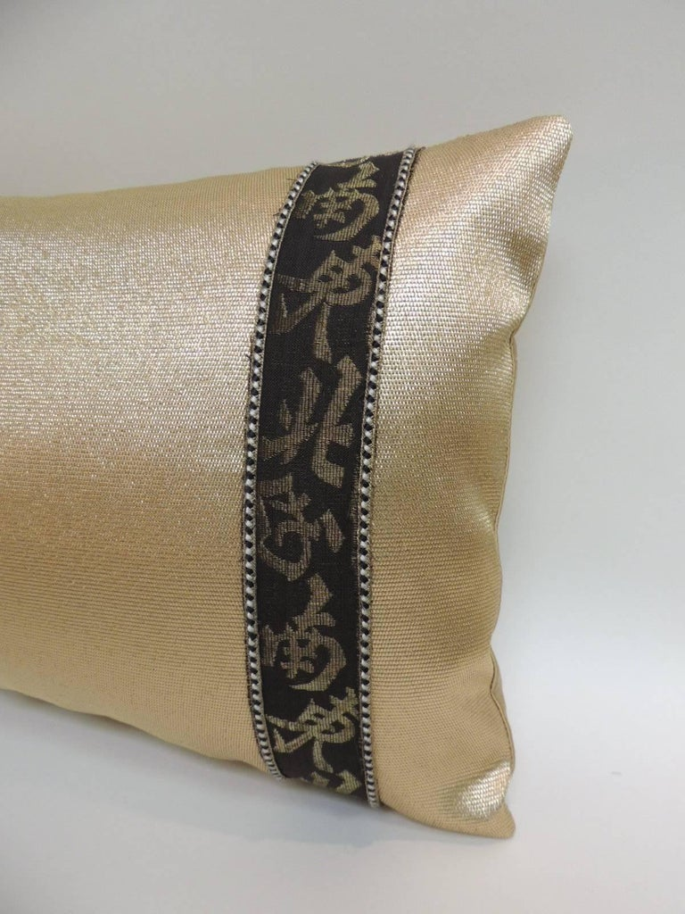 Vintage gold and black Obi textile lumbar decorative pillows embellished with vintage woven Chinese trims and framed with small gold, black and silver decorative trims. Trims inspired by the old Chinese calligraphy and backed by golden silk