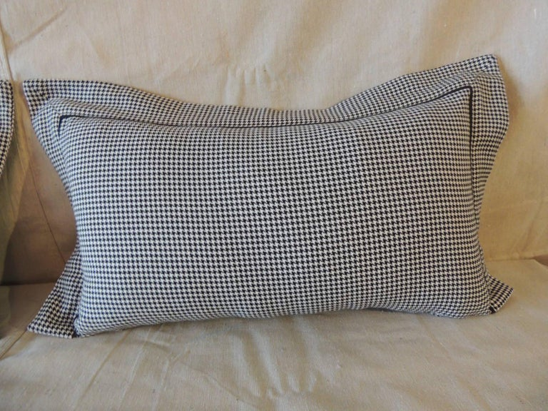 Pair of black and white Houndstooth pattern modern Lumbar decorative pillows. Small solid black trim and 2