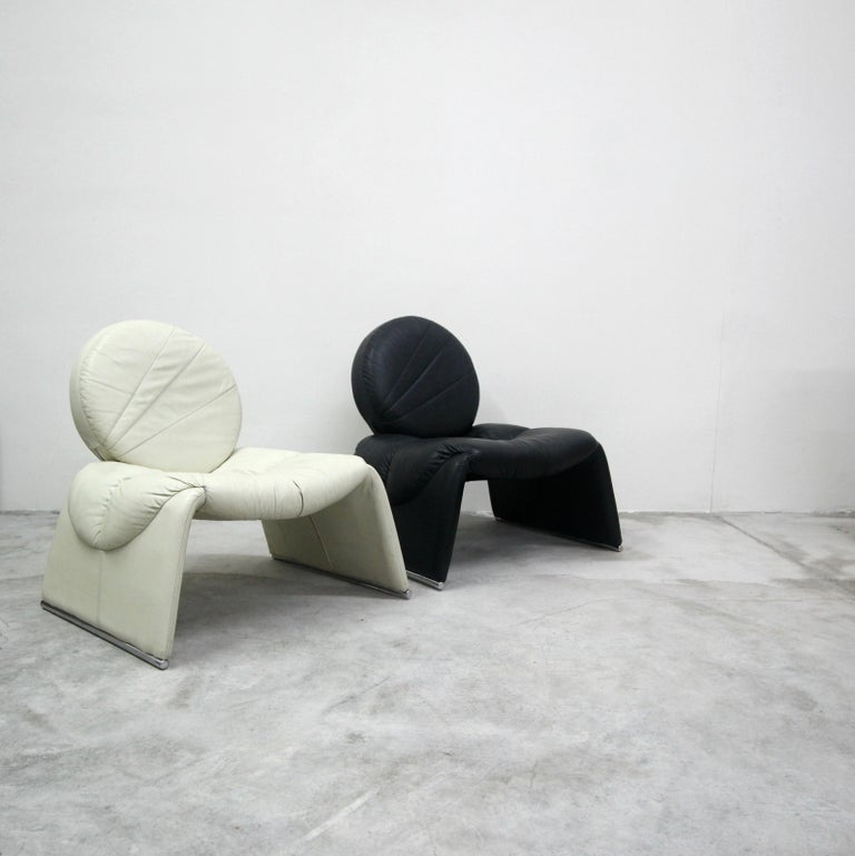 Black and white never looked so good. This pair of black and white leather vintage Italian lounge chairs are incredible. Similar is style to the Proposals chair by Vittorio Introini for Saporiti, but better. A very, very rare and unique