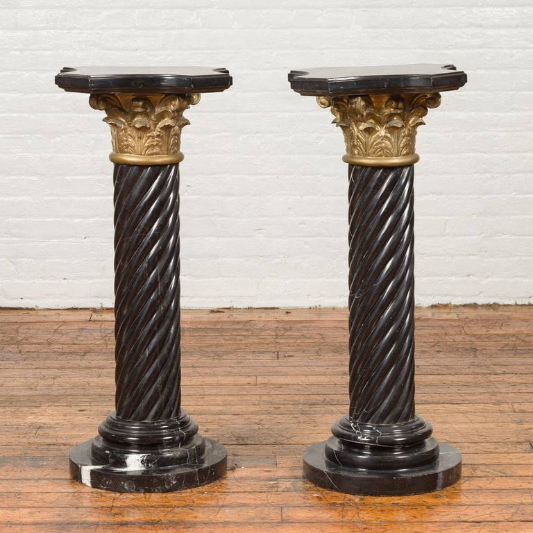 Thai Pair of Black Carrara Marble Twisted Pedestals with Bronze Corinthian Capitals For Sale