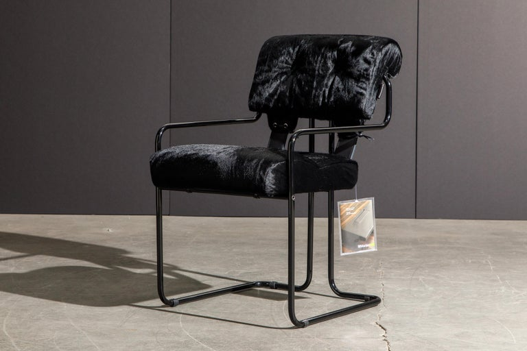 Currently, the most coveted dining chairs by interior designers are 'Tucroma' chairs by Guido Faleschini for i4 Mariani, and we have this incredible pair (2) of Tucroma armchairs in beautiful black cowhide leather with black lacquered frames. The