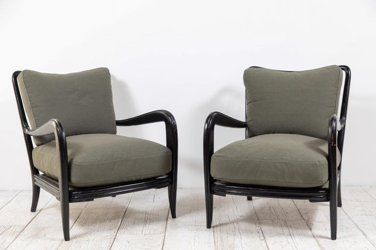 Pair of Italian midcentury black framed spindle chairs newly upholstered in a green ripstop fabric from Howe textiles of London.