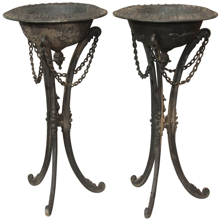 Pair of Black Iron Standing Urns or Planters For Sale