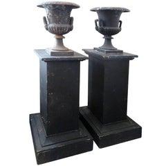 Pair of Black Iron Urns on Pedestals