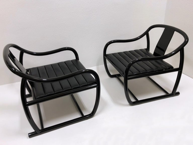"""Pair of black lacquered and leather 'L'Chine' lounge chairs. Designed by Renowned American designer Stanley Jay Friedman in the 1970s. The chairs are in beautiful vintage condition with minor wear consistent with age.  Measurements: 28"""" wide,"""