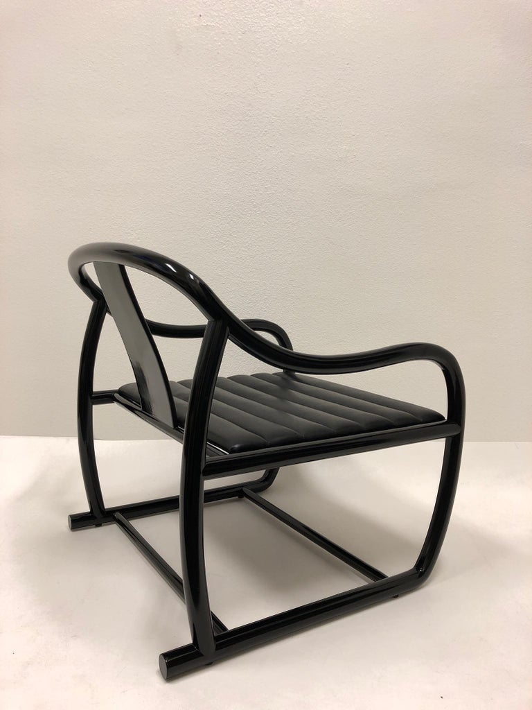 American Pair of Black Lacquered and Leather Lounge Chairs by Stanley J Friedman For Sale