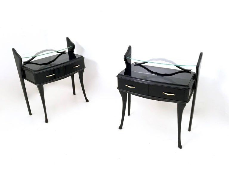 Made in black lacquered wood.