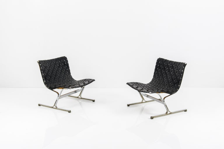 Pair of Luar lounge chairs designed by Ross Littel and manufactured by ICF De Padova, Italy, 1965. Black stripes and chrome-plated solid metal frames Great vintage condition and leather patina. Excellent quality.
