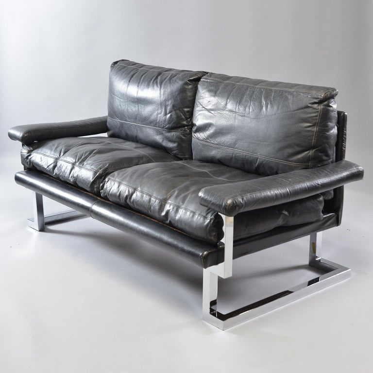 English Pair of Black Leather and Chrome Sofas by Tim Bates for Pieff & Co