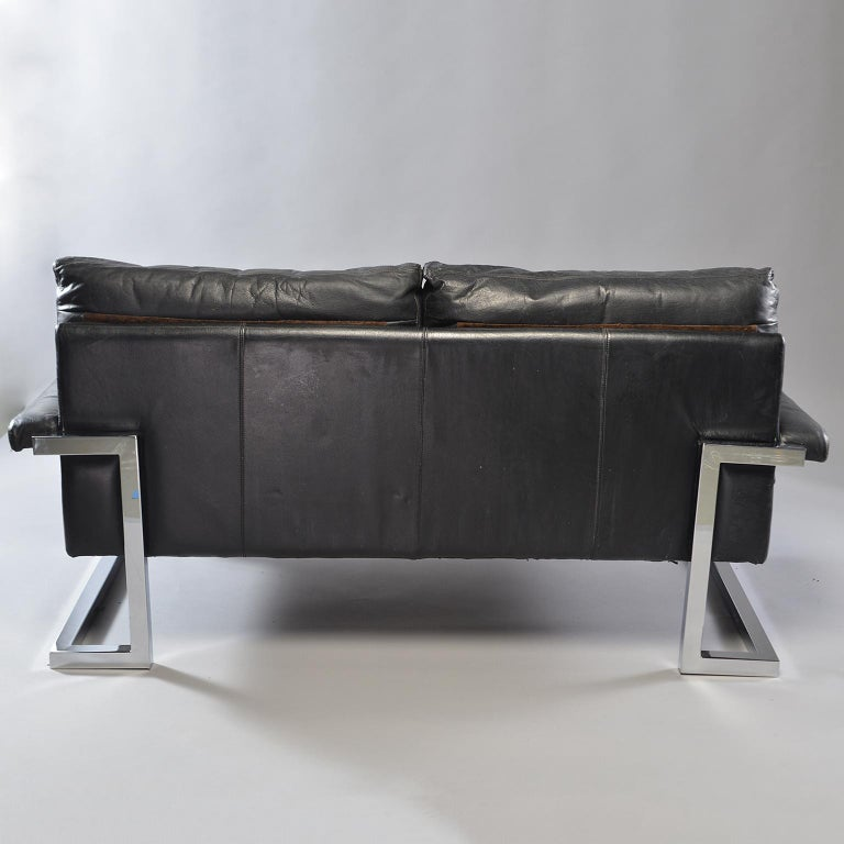 Pair of Black Leather and Chrome Sofas by Tim Bates for Pieff & Co In Good Condition In Troy, MI
