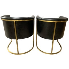 Pair of Black Leather and Gold Steel Rounded Barrel Back Chairs