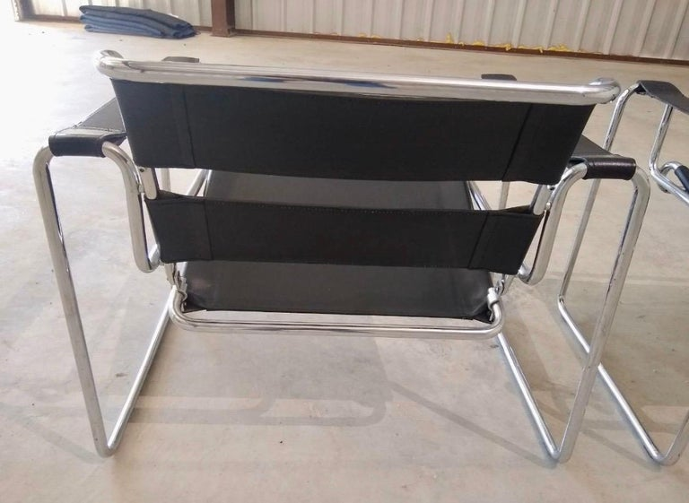 Iconic Marcel Breuer style black leather Wassily chairs, circa 1980s. Made in Italy. There are no manufacturer hallmarks. The leather and chrome is in great pre-owned condition especially given their age. In spirit and stature, the Wassily chair