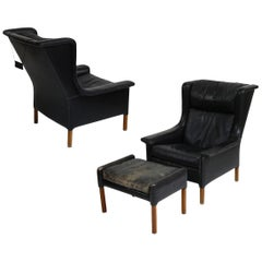 Pair of Black Leather Wingback Chairs and Ottoman by Gerhard Berg, 1965