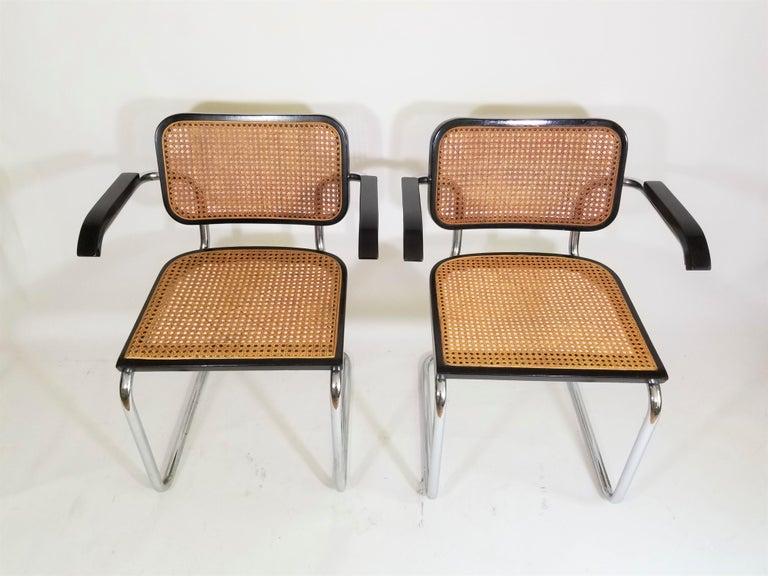 Midcentury Marcel Breuer Cesca chairs. Black finish. Cane seats and backs. Classic chrome cane. Caning intact and a beautiful Carmel color. Made In Italy.  Complimentary Delivery in NYC and surrounding areas can be arranged for this