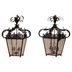 Pair of Black Metal Neoclassical Lanterns with Palm Frond Tops