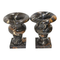 Pair of Black Variegated Marble Campana Form Urns