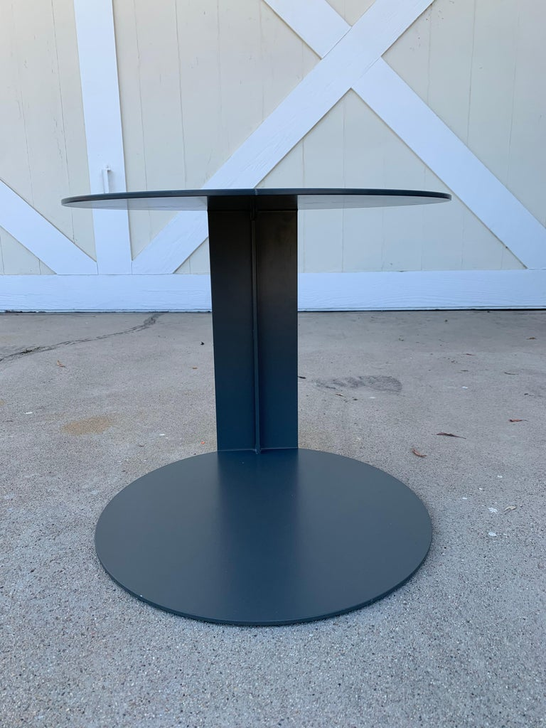 Pair of round side tables entirely made of epoxy powder painted metal in grey, designed and manufactured in Italy by Verzelloni and part of the BLOG collection.  Measurements: 17 inches deep x 17.25 inches wide x 16 inches high.