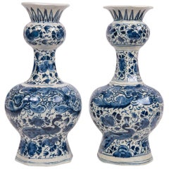Pair of Blue and White Delft Vases Decorated with Peacocks and Flowers