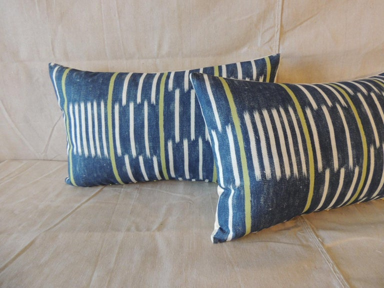 Pair of blue and white Ikat style modern lumbar decorative pillows.