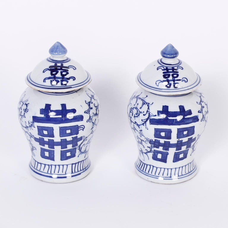 Chinese blue and white porcelain lidded jars with Classic form and decorated with the familiar joy and unity symbol of double happiness on the front and back.