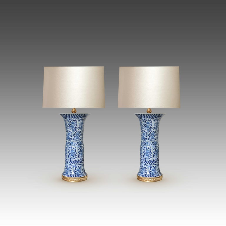 Fine painted blue and white porcelain lamps other fine cast gilt bronze bases to the top of the porcelain vase 20 inch.
