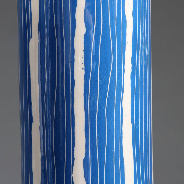 A pair of blue and white Studio Pottery vases of cylindrical form, now converted as lamps.  Currently wired for the UK. Please enquire for rewiring services.  Please note: lampshades not included.