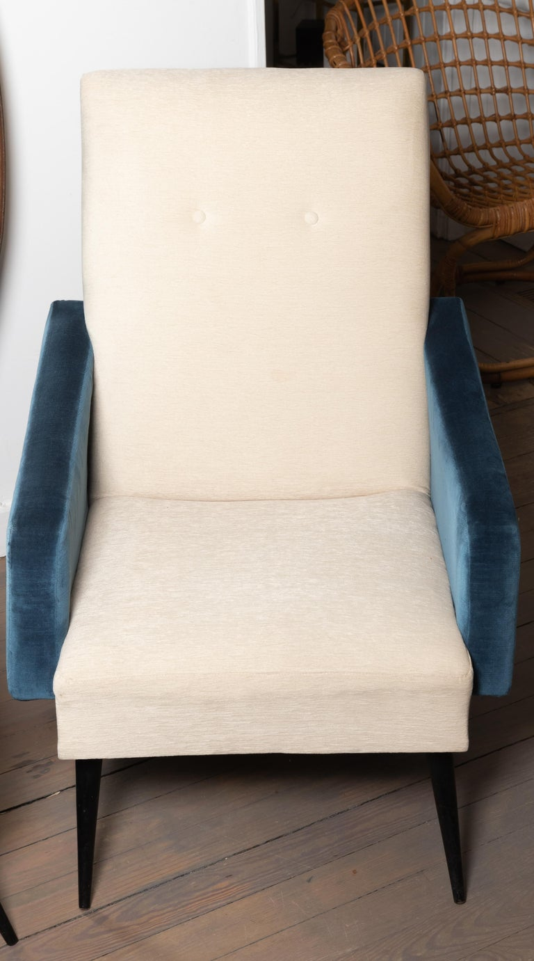 Pair of blue and white upholstered armchairs.