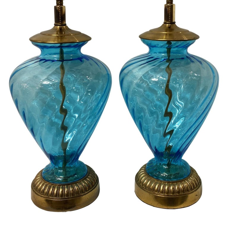 Pair of circa 1940's Italian blown glass table lamps with bronze bases.  Measurements: Height of body 19