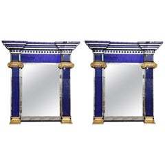 Pair of Blue Paneled Mirrors with Giltwood Details