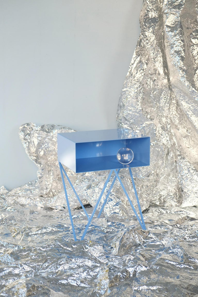 A pair of ice blue powder coated steel Robot bedside tables. Ice Blue is &New's new color for winter 2019. The Robot side table features an open shelf on zig zag legs. A fun and functional design made of solid steel, powder coated in blueberry. The