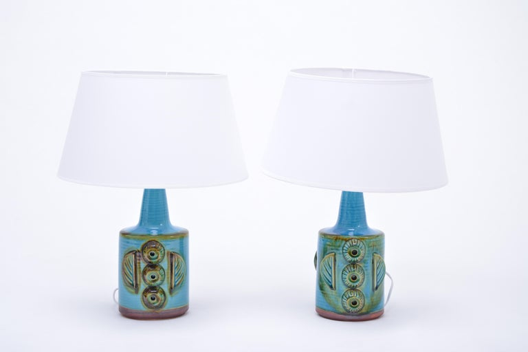 Pair of blue table lamps made of stoneware with ceramic glazing in light blue. The bases feature ceramic applications. Produced by Danish company Søholm. The lamps have been rewired for European use and have new shades. To be checked by a local