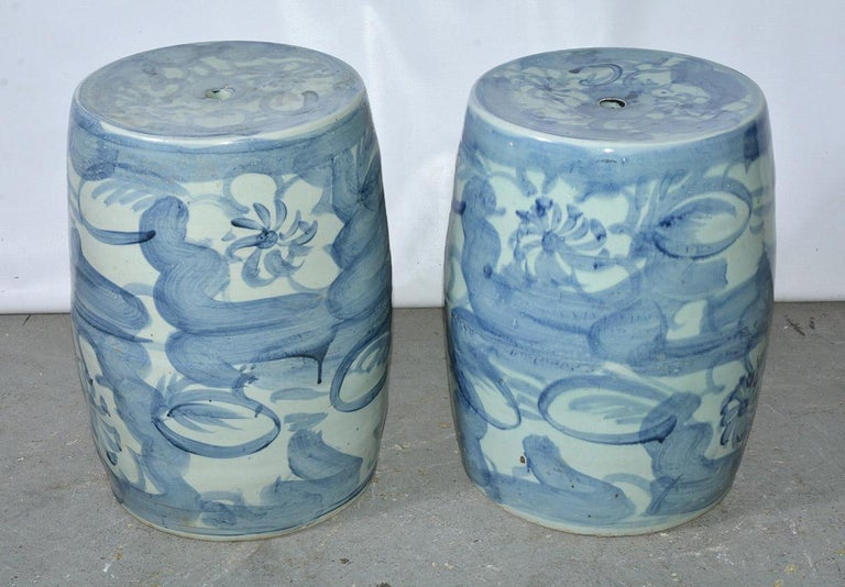 .Chinese blue and white porcelain drum shape garden stools in floral motif. The ceramic stools can be used as plant stand, side table or extra seating. Wonderful in a garden room, porch, or the most elegant living room.