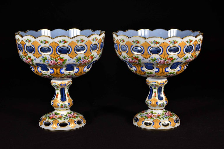 A pair of large glass fruit bowls. It is a light cobalt glass inherited from opal glass, handcut and hand painted, the painting is done with the original technique and several burns of colors, everything is made to order in the style of the 19th