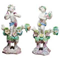 Pair of Bow Cherub Figures on Plinths, Decked with Flowers, circa 1765