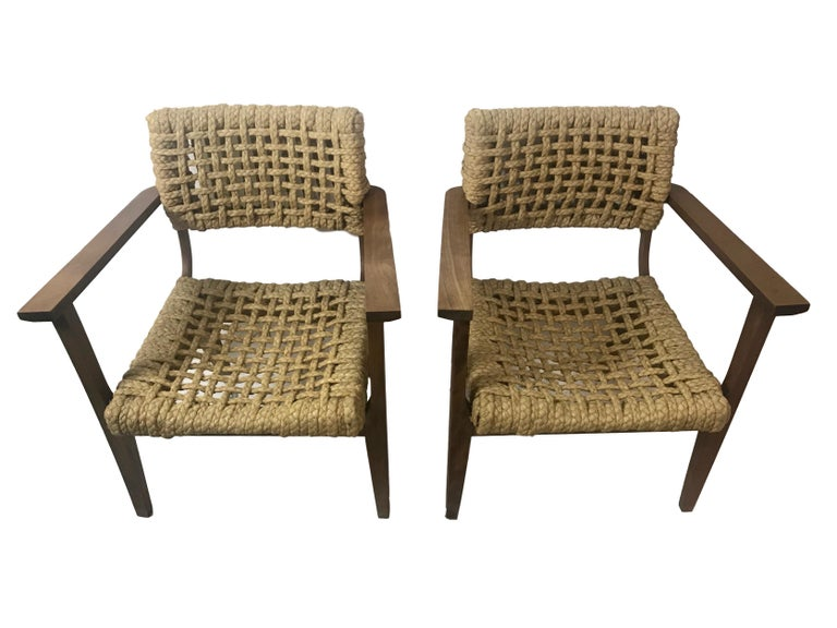 This is a beautiful pair of braided rope arm chairs by Adrien and Frida Audoux-Minet from Marseille France, circa 1950. The seat and backrest are made of woven hemp from the abaca plant, also known as