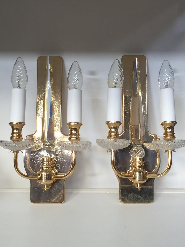 Brilliance and transparency for this pair of brass and crystal wall lights.