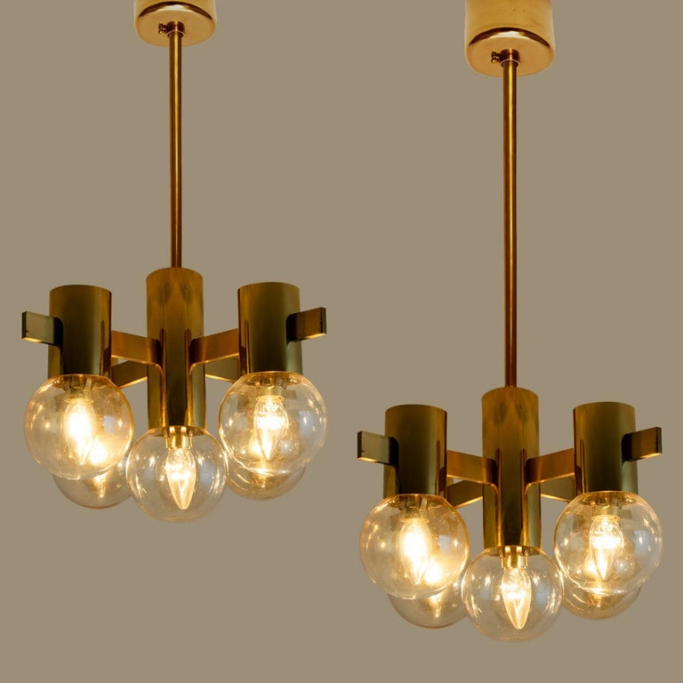 This stunning pair of large brass light fixtures with smoked glass bowls and gold-plated fittings was produced in the 1970s in the style of Hans-Agne Jakobsson. Illuminates beautifully.  Size of the chandelier: D 18.1