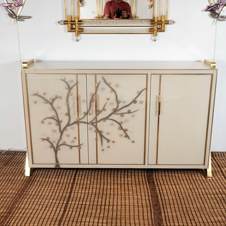 Custom made pair of Ivory glass with hand cut glass flowering branches sideboards handmade in Italy by a master artisan and artist. Wooden frame is veneered with ivory hand tinted Murano glass panels with brass inlays. Handmade and handcut