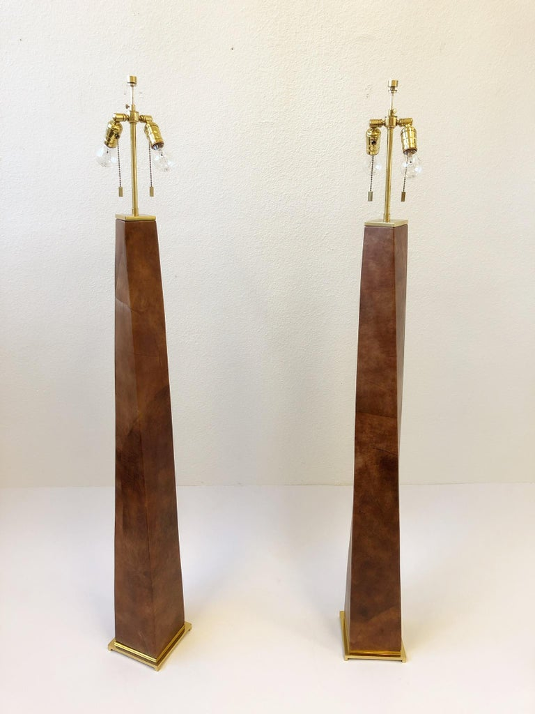 Polished Pair of Brass and Leather Floor Lamps by Karl Springer For Sale