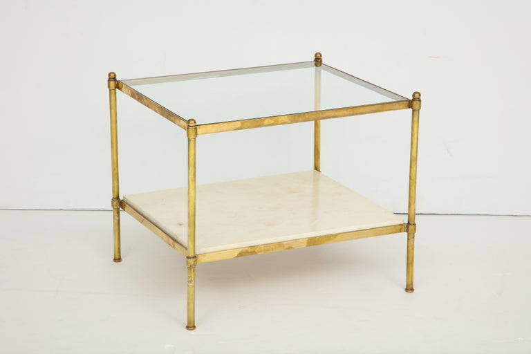 Pair of brass and parchment tables with glass tops.