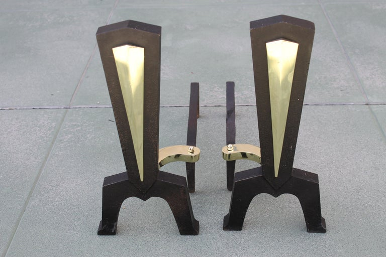 "Pair of midcentury fireplace andirons. We're reasonable sure they were designed by Donald Deskey. Brass portions have been polished. They measure 7"" wide 17.5"" deep and 16"" high."