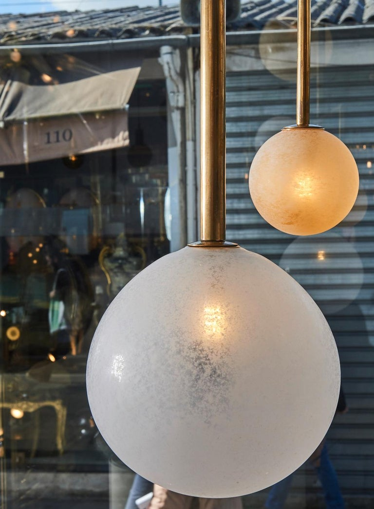 Frosted Pair of Brass Angular Chandeliers with Glass Globes For Sale