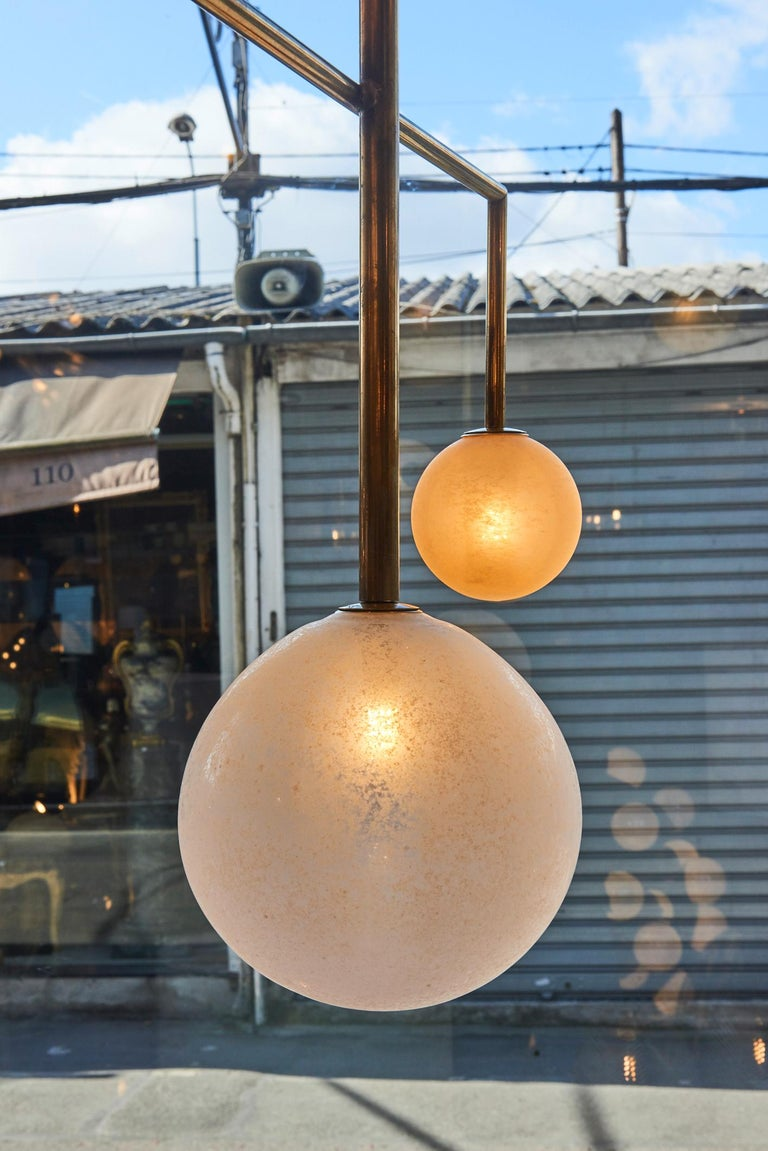 Pair of Brass Angular Chandeliers with Glass Globes In Good Condition For Sale In Saint-Ouen, IDF
