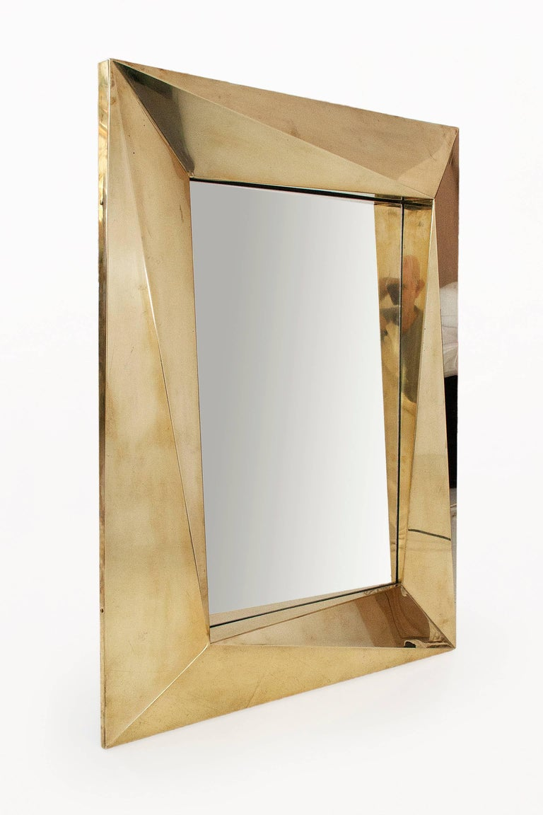 Pair of brass Brutalist wall mirrors. Frame with geometrical form, circa 2000, Italy. Very good condition.