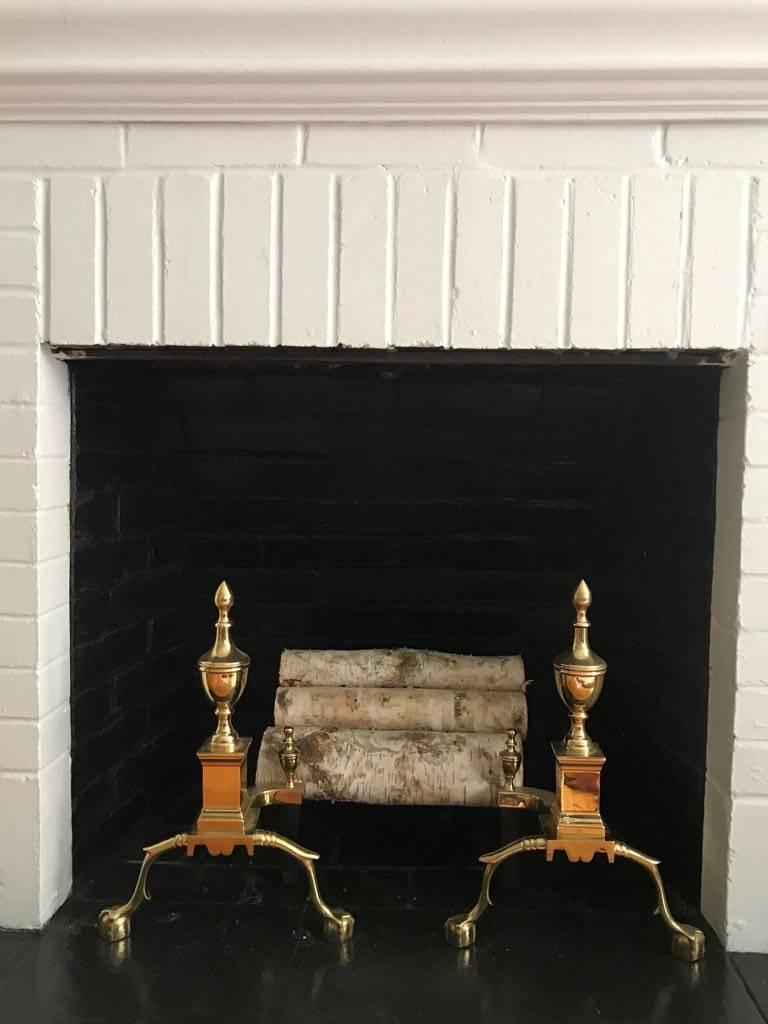 Classic pair of brass andirons, great size and presence.