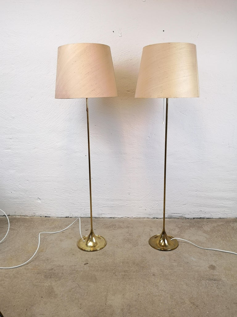 Wonderful design floor lamps from Bergboms Sweden. Made in brass and cast iron. They where made in the 1960 and have a nice shaped trumpet foot.  Good working condition, with some since of wear and stains to the brass.  Measures: H 133 cm x Dm