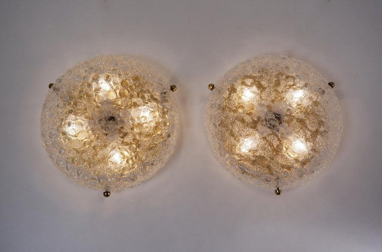 Pair of brass flush lights with glass shade by Hillebrand Lighting, circa 1970s, German.