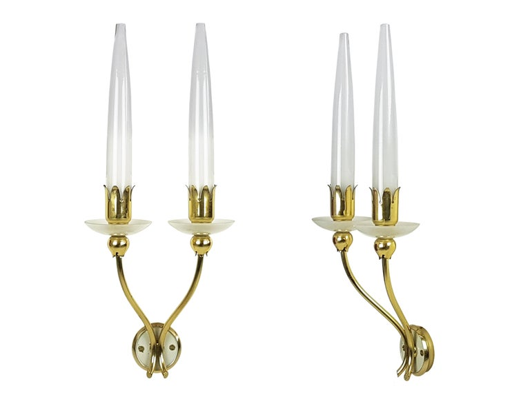 Pair of wall fixtures made from a brass structure with sandblasted and translucent saucher and shades. Very good condition.