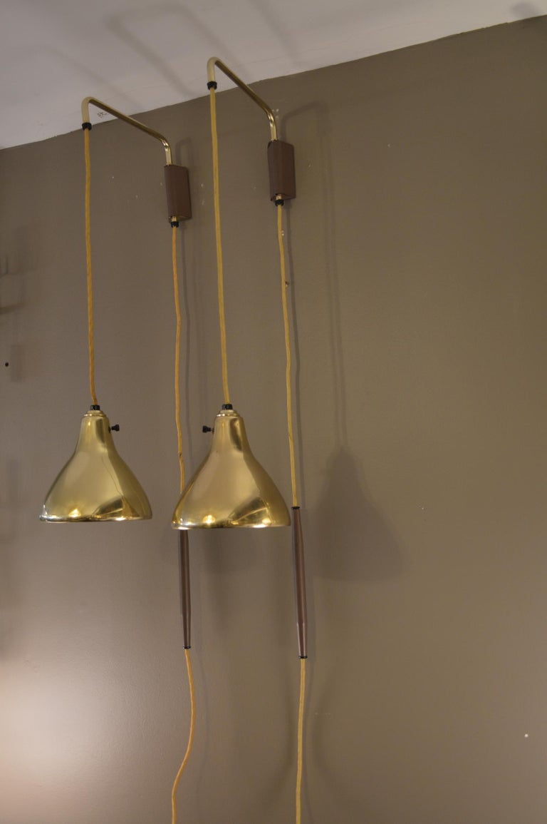 Pair of 1950s brass hanging sconces.
