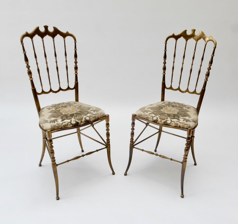 Pair of brass Italian chairs by Chiavari with the original fabric.
